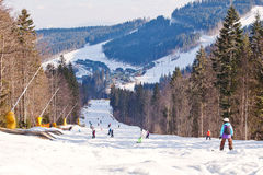 Skiers and snowboarder descends from the mountain Stock Photography