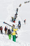 Skiers and snowboarders climb the mountain for freeride. KAMCHATKA PENINSULA, RUSSIA - MARCH 9, 2014: Skiers and snowboarders climbing the mountain for freeride Stock Photography