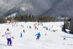Skiers and snowboarders enjoying good snow. JASNA, SLOVAKIA - February 12: Skiers and snowboarders enjoying on slopes of the best ski resort, Jasna, in Slovakia royalty free stock photos