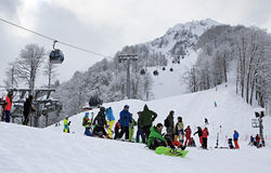 Skiers and snowboarders in Rosa Khutor Alpine Stock Photos