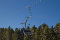 Skiers and snowboarders on a ski lift Stock Photos