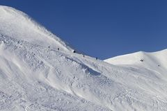Skiers and snowboarders on ski piste Stock Images