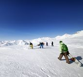 Skiers and snowboarders on ski slope Royalty Free Stock Photography