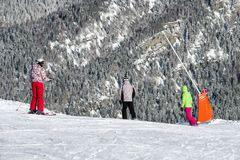 Skiers and snowboarders on the slope stock photo
