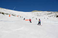 The skiers, snowborders and cableway in Jasna Low Tatras Stock Photos