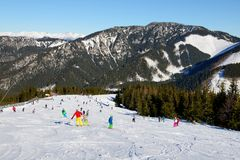 The skiers and snowborders are on slope in Jasna Low Tatras Royalty Free Stock Images