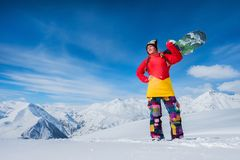 skiers stand in the background of snow mountains. man and gi Royalty Free Stock Image