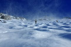 Skiers in a storm of blown snow Stock Photo