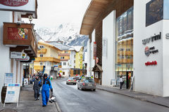 Skiers on street Dorfstrasse in Solden Stock Image