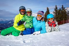 Skiers, sun and fun. Family with two kids enjoying winter vacations Royalty Free Stock Images
