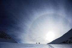 Skiers and sunset Royalty Free Stock Photo
