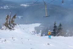 Skiers on T-bar ski lift in Szklarska Poreba, Poland royalty free stock photo