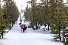 Skiers on T-bar ski lift in Szklarska Poreba, Poland royalty free stock image