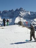 Skiers take a break to view the Dents du Midi Stock Photography