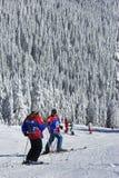 Skiers taking a break. After descending a black run on kopaonik mountain stock photo