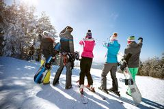 Skiers on the top of the mountain, back view royalty free stock images