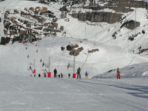 Skiers use the dragline to ascend the slopes Stock Photo