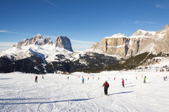 Skiers in Val Gardena Ski resort. Skiing in one of the most beautiful ski resort from Val Gardena Royalty Free Stock Images