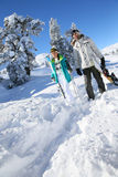 Skiers walking in the snow Stock Photos