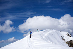 Skiers walking uphill for freeride Royalty Free Stock Photos