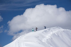 Skiers walking uphill for freeride Stock Photo