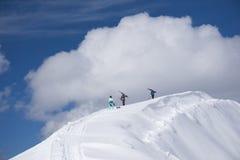 Skiers walking uphill for freeride Stock Photo