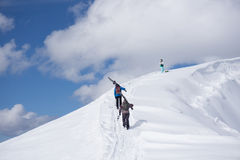 Skiers walking uphill for freeride Stock Photos