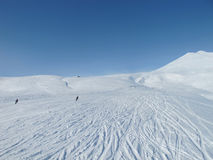 Skiers on wide open piste in French alps Stock Images