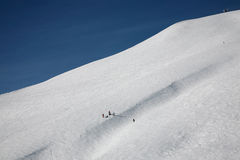 Skiers on wide track Stock Photography