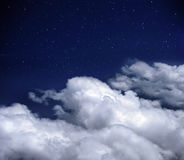 Skies background. Blue sky with clouds and stars stock images