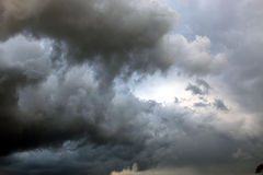 In the skies. Clouds on a blue skie just before the storm stock images
