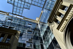 Skies in glass. Modern architecture with reflection of the sky and influence on business processes Stock Photo