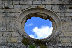 Skies through hole in wall Stock Image