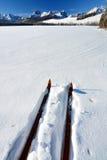 Skies point across a frozen lake Royalty Free Stock Photos