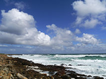 Skies and surf at Cape of Good Hope South Africa. Indigo blue skies contrast against white and frothy surf on a windy day at the Cape of Good Hope at the stock photo