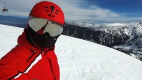 Skieur sur la montagne neigeuse Images libres de droits