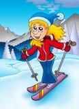 Skifahrenfrau in den Bergen Stockbild