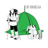 Skifahrer mit Zelt und Thermosflasche Stockfotos