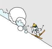 Skifahrer u. Lawine Stockfotos