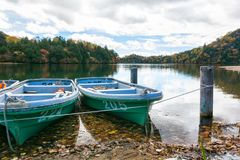 Skiff boats, lake and blue sky nature Stock Photography