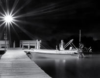 Skiff at night Stock Photos