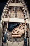 Skiff. Old skiff with life jackets and old worn oars Royalty Free Stock Photos