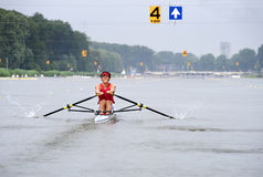 Skiff rowing. A Skiff oarsman in lane 4 during a rowing regatta Stock Images