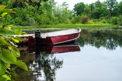 Skiff tied up at a dock Royalty Free Stock Photos