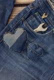 Skiftnyckel i facket av jeans dagfader lyckligt s Arkivfoton