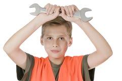Skiftnyckelfast utgift för öppet av pojken Arkivbild