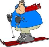Skiier con una bufanda roja Imágenes de archivo libres de regalías