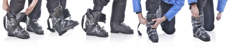 Skiier demonstrate how to put on the ski boots Royalty Free Stock Photography