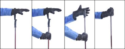 Skiier demonstrate how to put on the ski sticks Royalty Free Stock Image