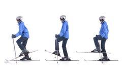 Skiier demonstrieren, wie man Balancenübung im Skifahren verwendet Stockbild